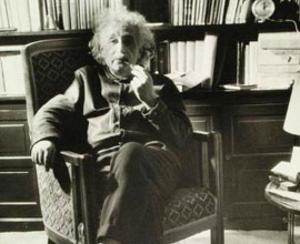 A picture of Albert Einstein wearing no socks