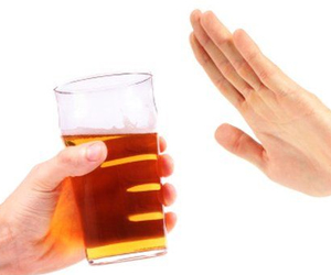 A picture of someone saying no to alcohol